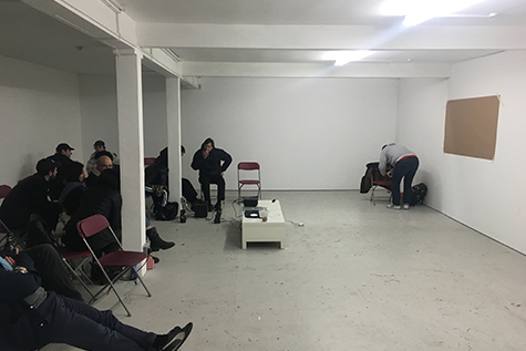people sitting together in a gallery